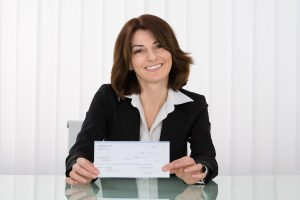 Businesswoman offering a check