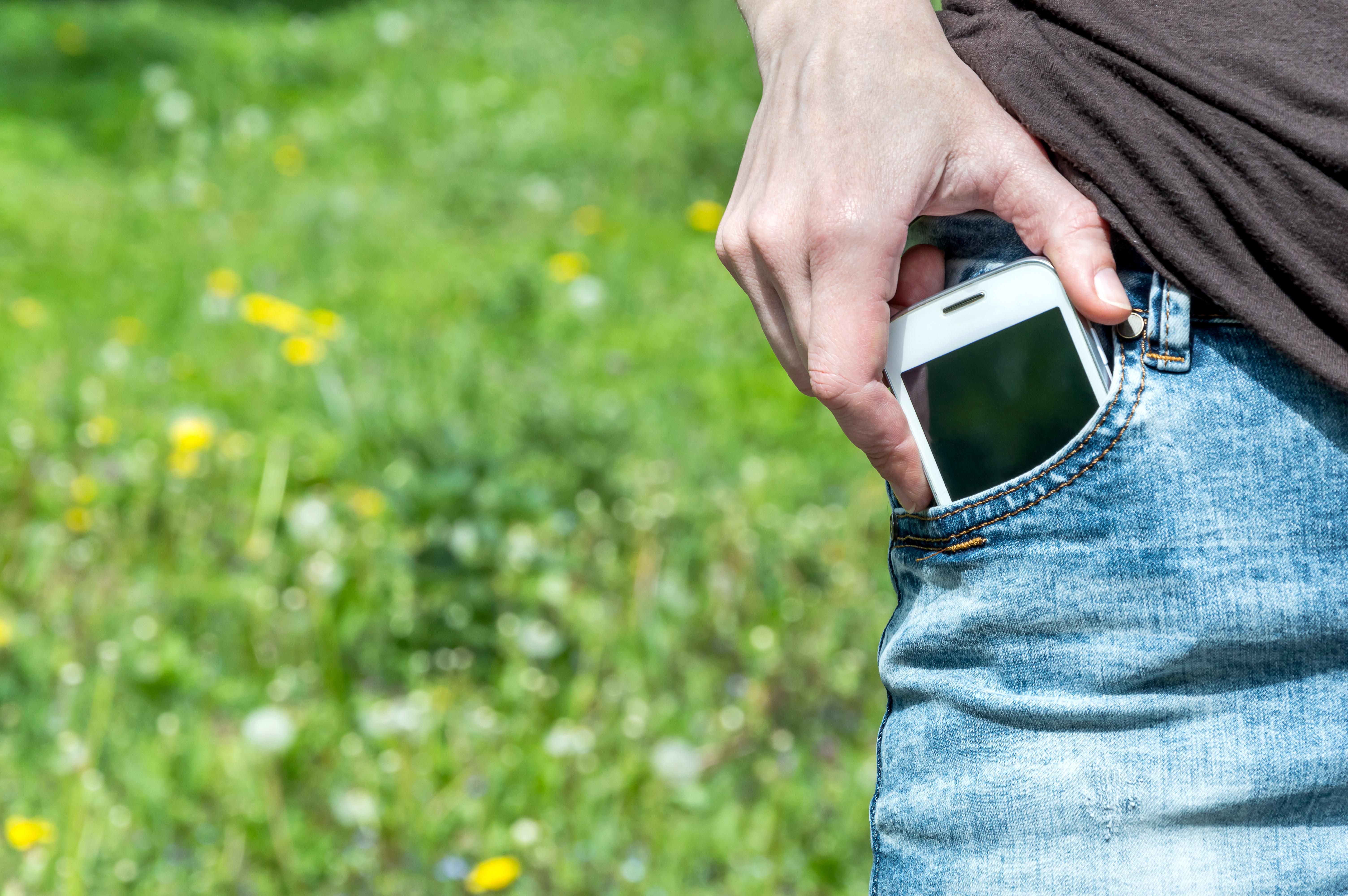 Individual grabbing phone from pocket