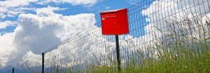 Red mailbox in a field