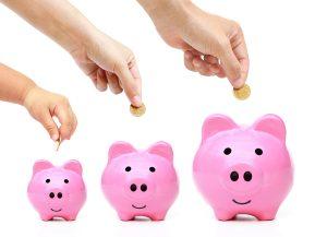 family saving money in piggy banks