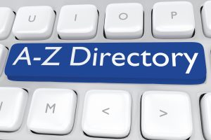 "computer keyboard with the print ""A-Z Directory"" on a dark blue button"
